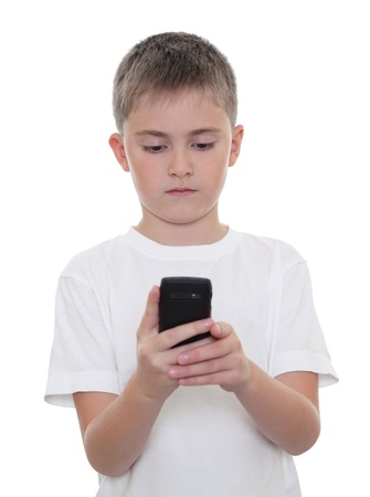 A boy searching something in his mobile phone photo