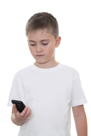 A boy searching something in his mobile phone