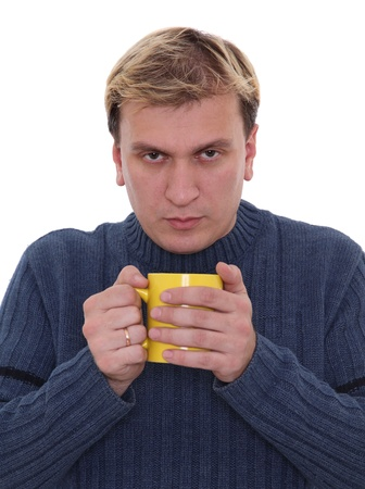 Man with cup of hot drink trying to cope with cold Stock Photo - 13158402