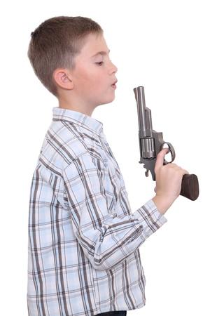 blow out: Boy imitating the blow out of gun smoke