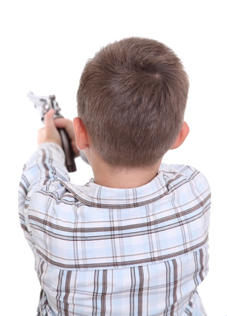 leveling: Boy leveling a gun at imaginary shooting mark Stock Photo