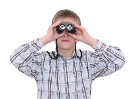 widening: Boy staring into the distance with a help of binoculars Stock Photo