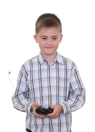 Boy holding a remote controller from his toy car