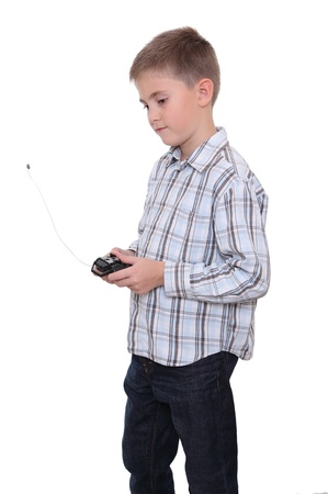 Boy holding a remote controller from his toy car, side view