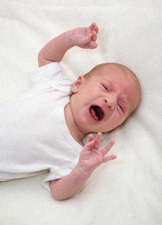 Newborn baby crying in the cot Stock Photo - 14639930
