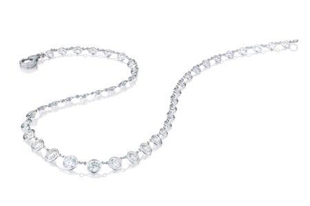 Diamond  necklace on a white background with reflection
