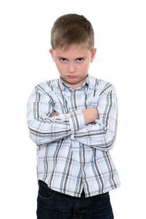 dissatisfaction: Boy in wounded pose on a white background Stock Photo