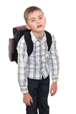 The tired schoolchild with a heavy satchel on shoulders, on white background