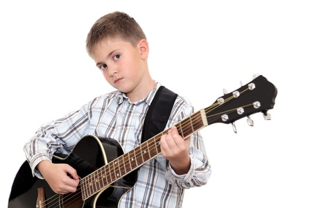 The boy with a six-string acoustic guitar on a white background
