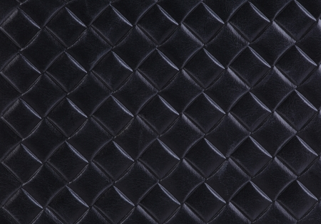 Texture of black leather with imprinted geometrical drawing