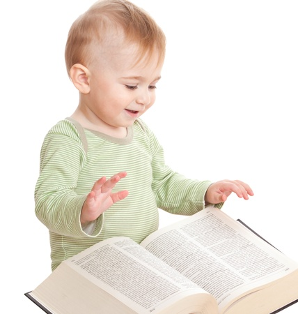 The smiling child sits with the big book Stock Photo