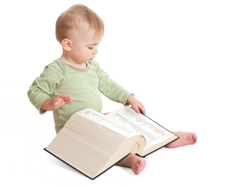 Child reads a big book  On a white background