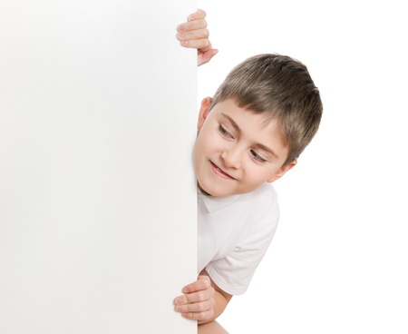 aside: Boy peep out through white poster, look on poster