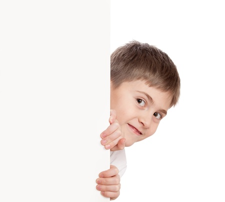 Boy look out through poster, looks directly Stock Photo