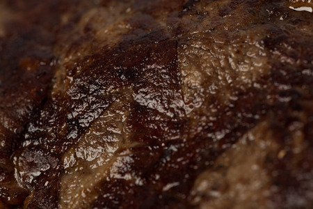 Beef steak prepared on a grill. Close up. Stock Photo