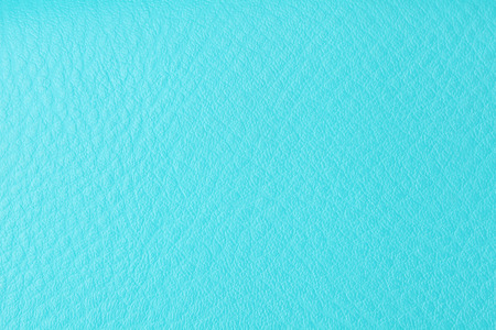 Background with texture of azure leather. Close up. photo