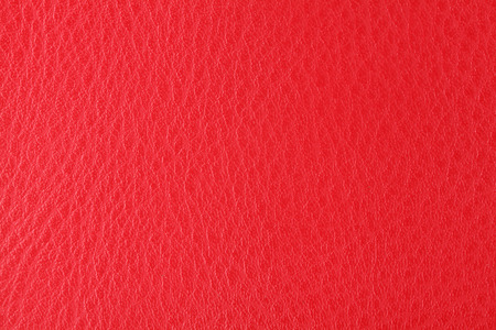Background with texture of scarlet leather. Close up. photo