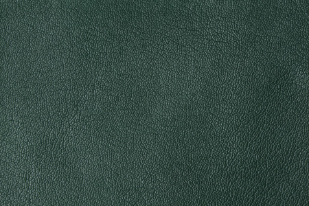 Background with texture of green leather. Close up. Stock Photo