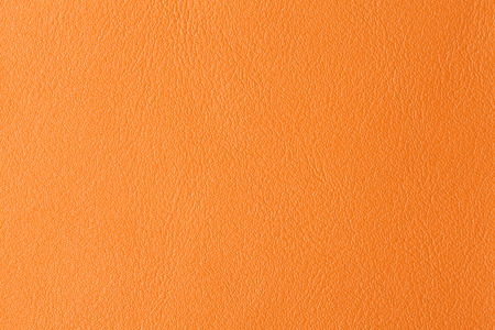 Background with texture of orange leather. Close up. photo