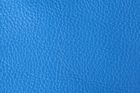 Background with texture of blue leather. Close up. photo