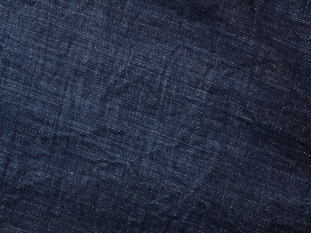 Background with texture of blue denim. ?lose up.