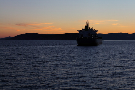 liner transportation: Silhouette of the sea ship against a sunset. Adriatic sea.