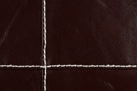 Close up of red-brown leather. Can be used as a background.