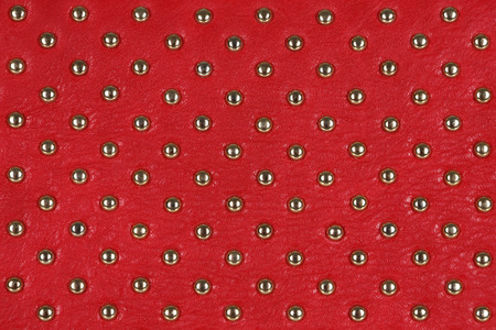 Close up of red leather with rivets. Can be used as a background. Stock Photo