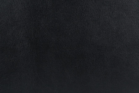 leatherette: Close up of black leather. Can be used as a background. Stock Photo