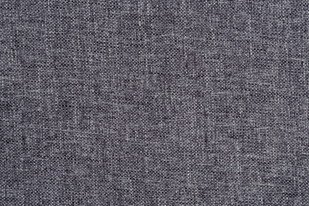 cloth manufacturing: Close up of grey fabric. Can be used as a background.