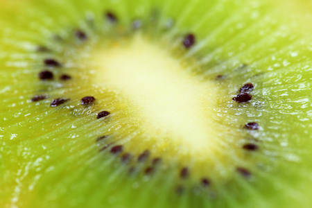 sharpness: Close up of a cross cut of a kiwi with the small depth of sharpness