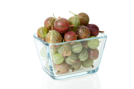 Gooseberry in a glass cup on a white background