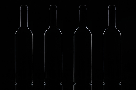 winy: A number of wine bottles on a black background Stock Photo