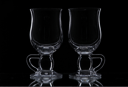 viniculture: Silhouette of two glasses on a black background