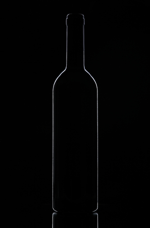 winy: Silhouette of a wine bottle on a black background