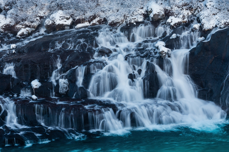 The waterfall Hraunfossar in Iceland, February