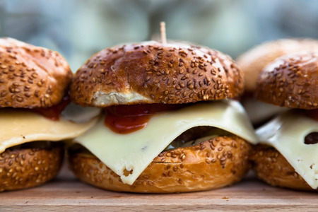 appetizing: Some of appetizing cheeseburgers on a wooden board