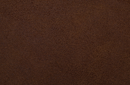 cloth manufacturing: Close up of texture of a brown imitation leather Stock Photo