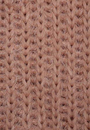 The close up texture of coral knitted fabric, can be used as a background