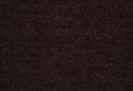 The close up texture of brown fabric, can be used as a background