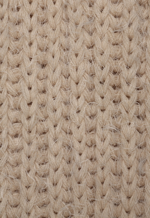 The close up texture of beige knitted fabric, can be used as a background Stock Photo