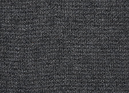 The close up texture of gray knitted fabric, can be used as a background Stock Photo