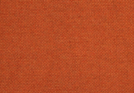 The close up texture of orange fabric, can be used as a background