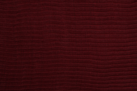 The close up texture of red folded fabric, can be used as a background Stock Photo