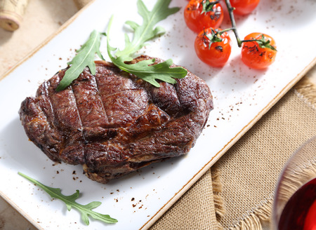 The steak from beef is served on a table Stock Photo