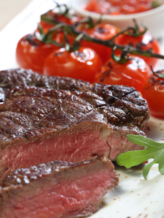 Beef steak on a plate, a close up Stock Photo