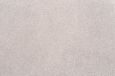 Photo picture of golden eco leather. Close up of golden foil leather. Could be used as background.