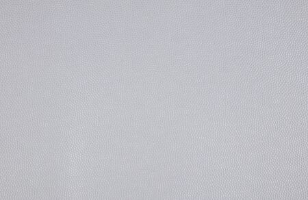 Photo picture of grey eco leather. Close up of artificial leather. Small grain. Could be used as background.