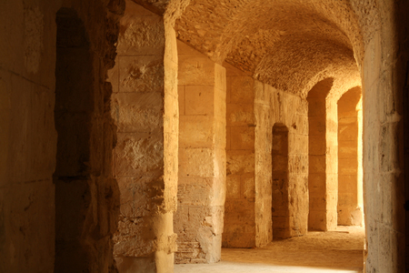 Beautiful antique stone arches of the Colosseum with sunlight Imagens