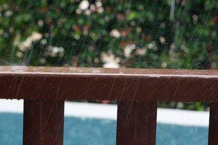 Rain drops on wooden railing